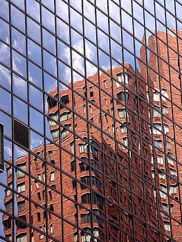 Building reflection by Tony Cordoza