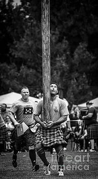 Caber Toss - Scottish Festival and Highland Games by Gary Whitton