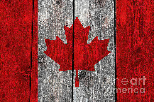 Canada flag on heavily textured woodgrain by Bruce Stanfield
