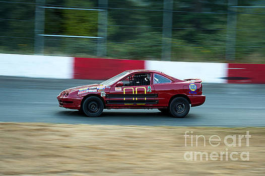 Car 00 in the turn by Wayne Wilton