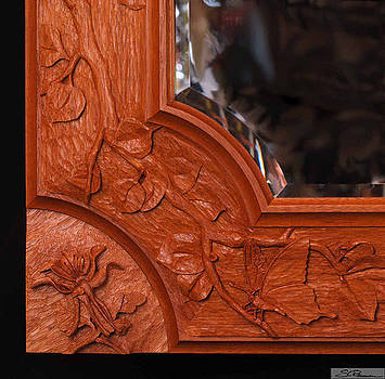 Carved mirror frame by Scott Reuman