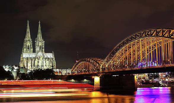 Cathedral, Bridge and Boat in Cologne by Holger Ostwald
