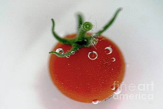 Cherry Tomato in water by Yumi Johnson