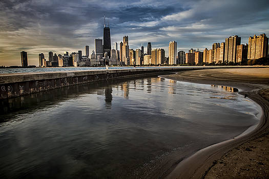 Chicago beach and Skyline with a person for scale by Sven Brogren