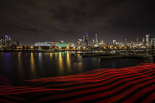 Chicago Skyline with red pixel stick at night  by Sven Brogren
