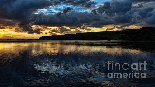 Cloudy Sunrise by Trena Mara