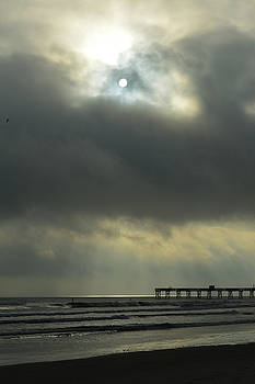 Cloudy sunrise with moon by Julianne Felton