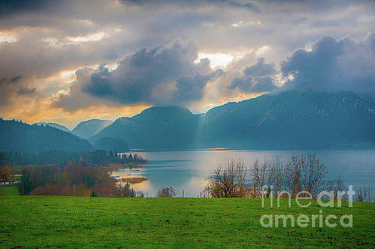 Cloudy sunset over Mondsee, Upper Austria by Jivko Nakev