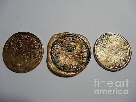Coin Trio pendants by Megan Brandl
