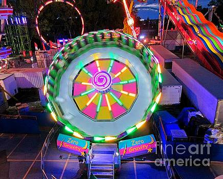 Colorful Fairground Rides at Night by John Malone