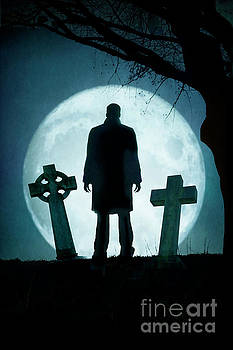 Creepy Man Standing In A Graveyard With Full Moon by Lee Avison