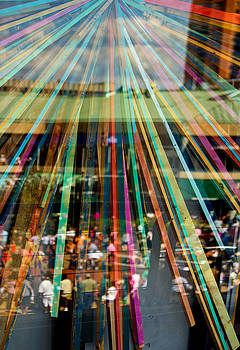 Crowd Reflection behind Colorful Streamers by Donna Haggerty