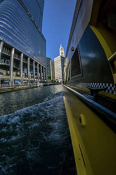 Cruising by Trump Tower and the Wrigely Building in Chicago by Sven Brogren