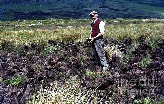 Joe Cashin - Cutting turf on The Comeragh Mountains