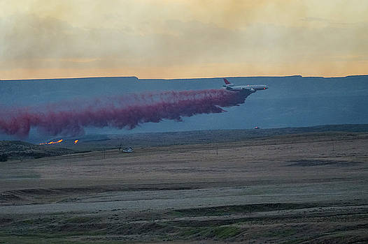 DC-10 drops retardant at sunset by Bill Gabbert
