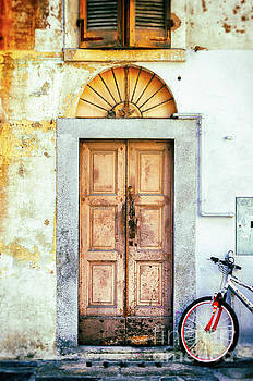 Decayed door and bicycle by Silvia Ganora