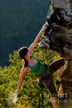Dusting the hand for climbing by Dan Friend