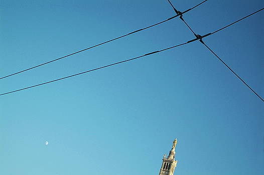 Sami Sarkis - Electrical wires cross in the sky with the tip of Notre Dame de la Garde in Marseille