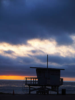 End Of Day On the Pacific. The sun sets on the Royal Palms Lifeguard shack.  by Joe Schofield