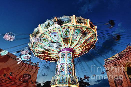 Evening Chain Swing Ride by George Oze
