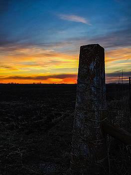 Fence Post Sunset by Dan McCafferty