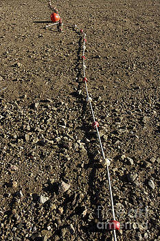 BERNARD JAUBERT - Float rope in the sand.