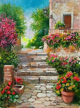 Flowering courtyard - Italy by Gioia Mannucci