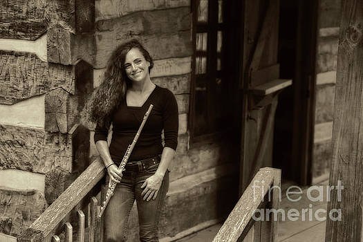 Flute player at the log home by Dan Friend