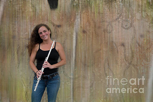Flute player at the wall by Dan Friend