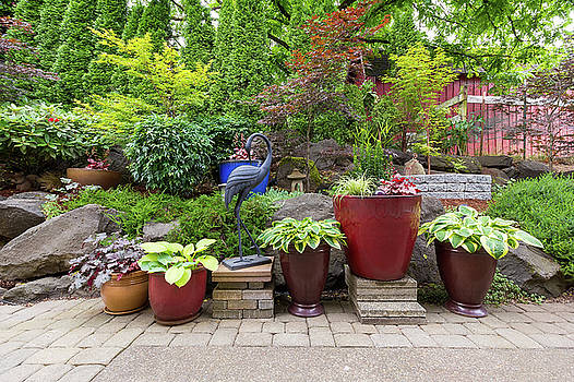Garden Backyard Landscaping with Plants and Stone Pavers by Jit Lim