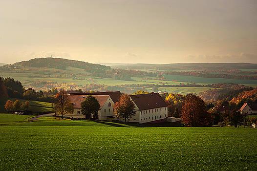 Jenny Rainbow - German Village in Autumn Day
