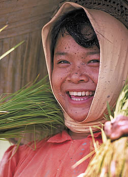 Girl Planting Rice in Philippines by Carl Purcell
