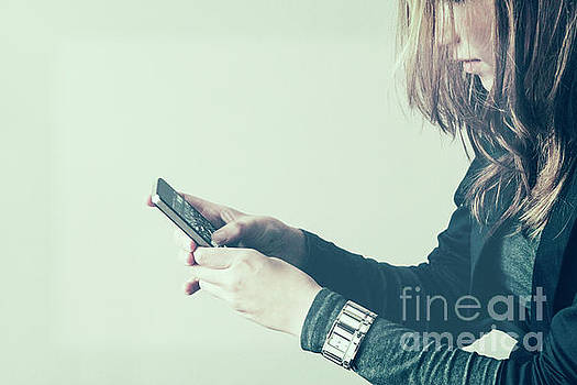Girl with phone by Patricia Hofmeester