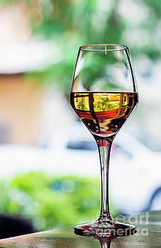 Glass Of Spanish Jerez Sweet Sherry Wine In Outdoor Cafe  by Jacek Malipan