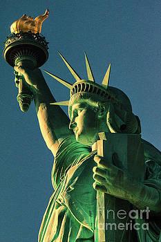 Chuck Kuhn - Glow of Statue of Liberty
