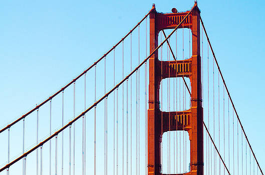Golden Gate Bridge and suspension cables on light blue sky background by Jirawat Cheepsumol