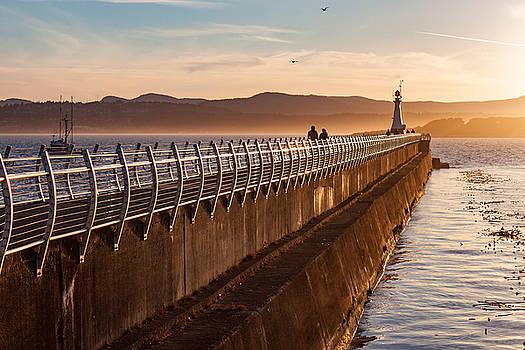 Golden Sunset Along Ocean Walkway by Steve Boyko