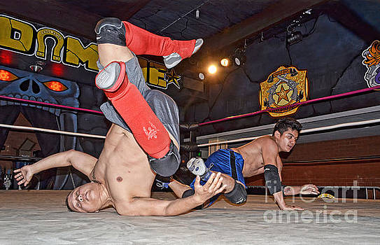 Hard Falls During Pro Wrestling Training  by Jim Fitzpatrick