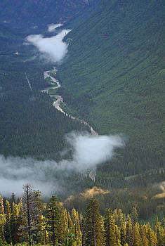 High Above the Clouds in Glacier National Park by Bruce Gourley