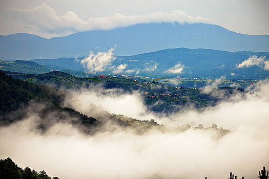 Hills and landscape in fog morning view by Dalibor Brlek