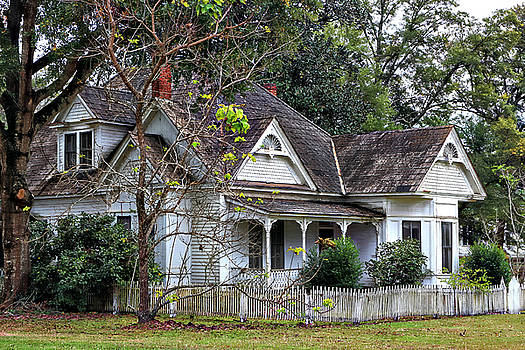 House with a Picket Fence by Lynn Jordan