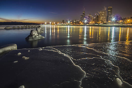 Ice and Chicago Skyline at dawn  by Sven Brogren