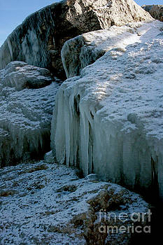 Icicles on the rocks by Kathy DesJardins