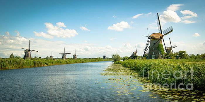 idyllic Kinderdijk by Hannes Cmarits
