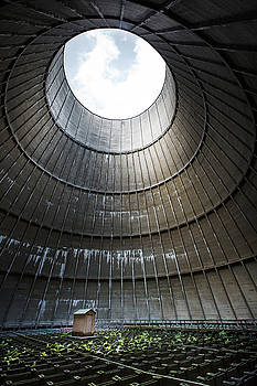Inside industrial cooling tower stands a mysterous little house by Dirk Ercken