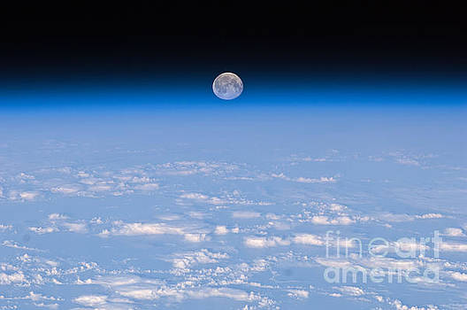 R Muirhead Art - International Space Station Backdropped by Earths horizon and the blackness of space a full moon
