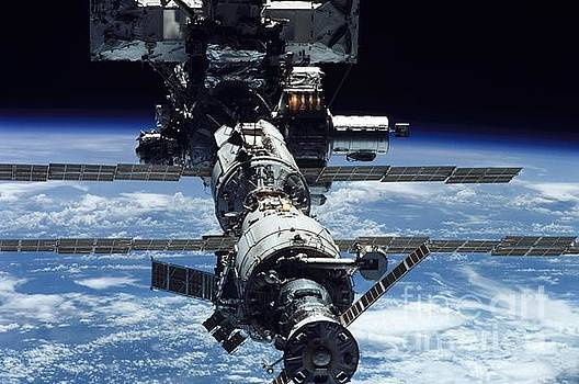 R Muirhead Art - International Space Station Backdropped by the blackness of space and a blue and white Earth