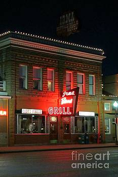 Irma Bar and Grill at Night in Cody Wyoming by John Malone