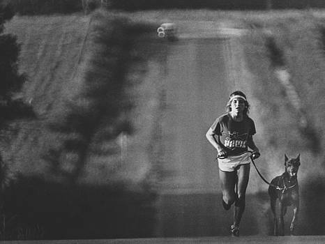 Jogger and dog by Jim Wright