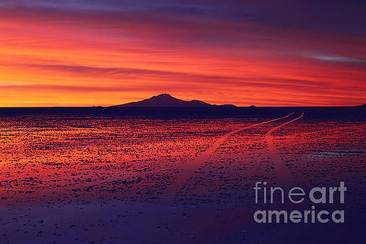 James Brunker - Journey Across the Salar de Uyuni at Sunset